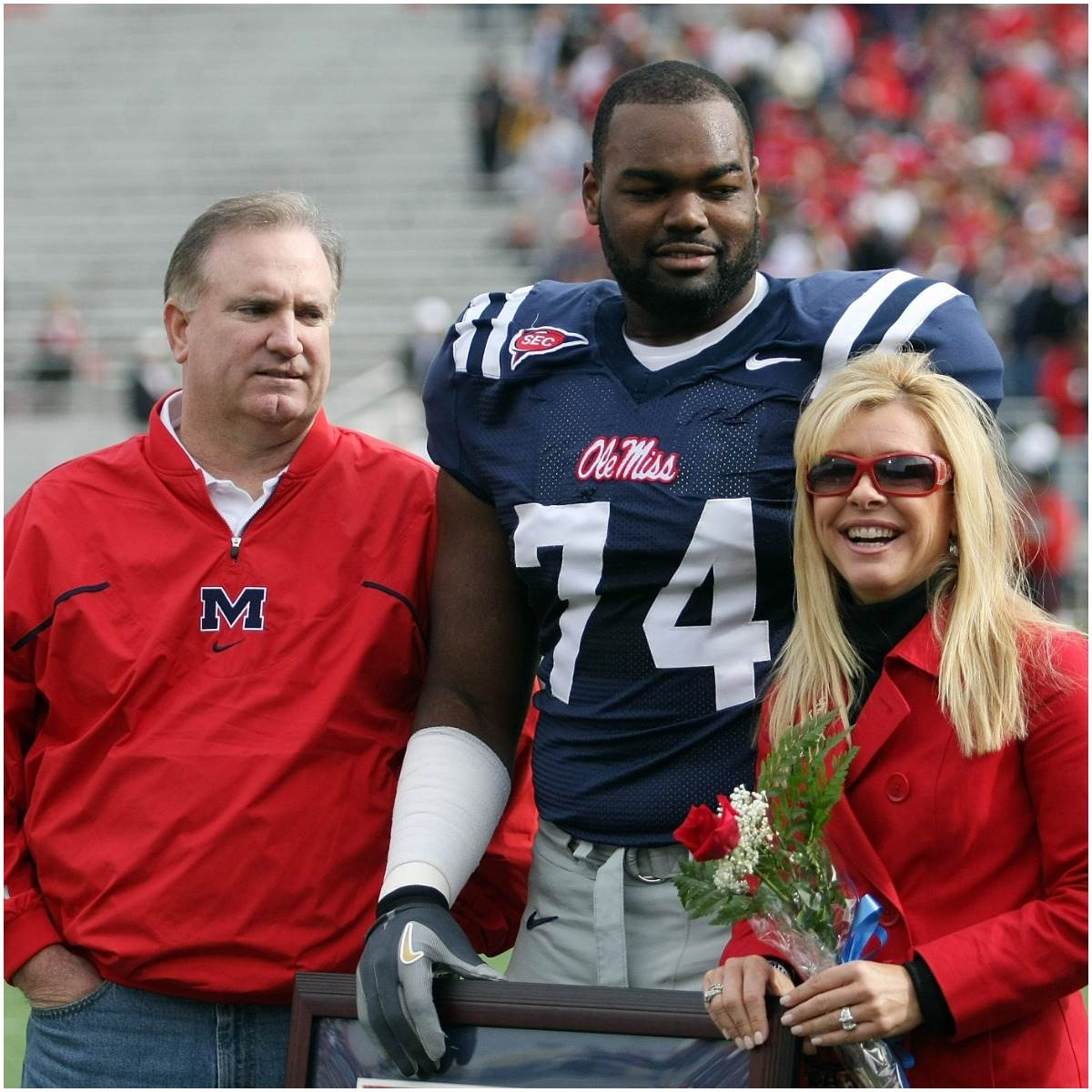 Michael Oher with his adoptive family